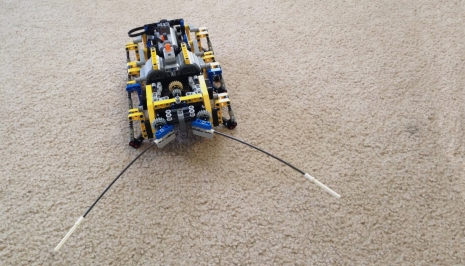"""My kids enjoy playing with the Lego characters and making them do stuff, like sharks eating people,"" Jungheim says. ""They do adventures together. Me, I tend to find myself in the corner building some crazy contraption that's remote controlled."" When it comes to Lego robots, like this bug, Jungheim does his own code programming."