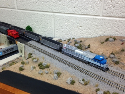 """""""This is my first attempt at model railroading,"""" Jungheim says. """"I just wanted to see if I could do it. It's all Styrofoam and plaster, and these rocks are from Rock Canyon and Slate Canyon. I grew up riding the rails in Europe and enjoyed watching trains, so this is something that I built. It's a very big hobby in Germany as well. The kids and the cat kept destroying it, though, so I brought it to the office."""""""