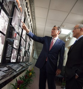 MItt and Scott Romney look at the new display during a campus visit.