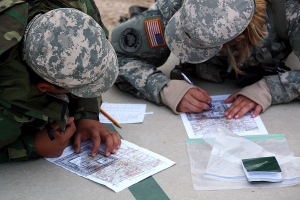 Cadets plot their points on a map for land navigation training.