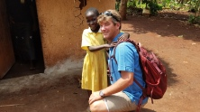 Photo courtesy of Peter Ward. Ward poses with a Ugandan girl that he and his family sponsor.